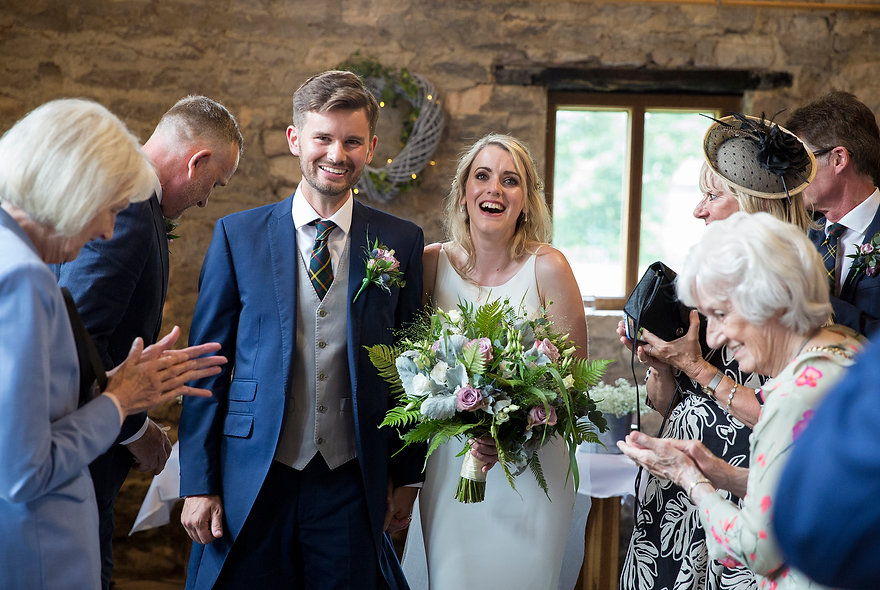 newly weds, just married, bride and groom leaving old barn, tithe barn Bradford-on-Avon
