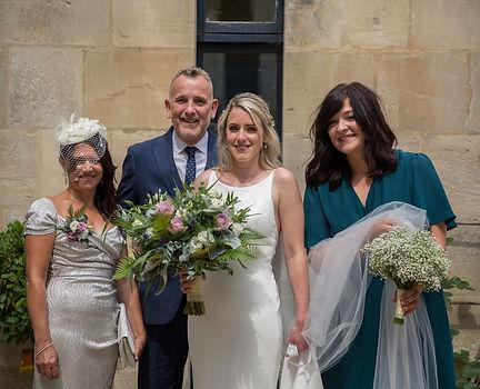 group shot of bride, parents and bridesmaid