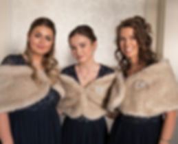 bridesmaids wearing faux fur shawls