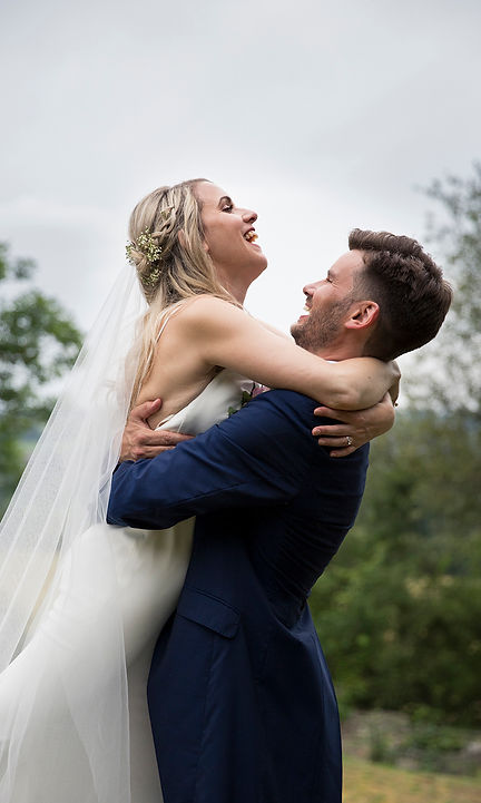 bride being lifted up by groom, avoncliff wedding photographer