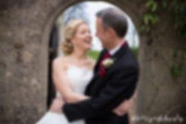 Happy bride and groom, arch, laughing, pose, smiling groom, winter wedding coombe lodge, bride and groom embrace