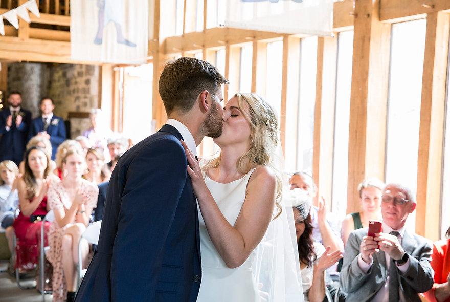 bride and groom kissing tithe barn, Bradford-on-Avon