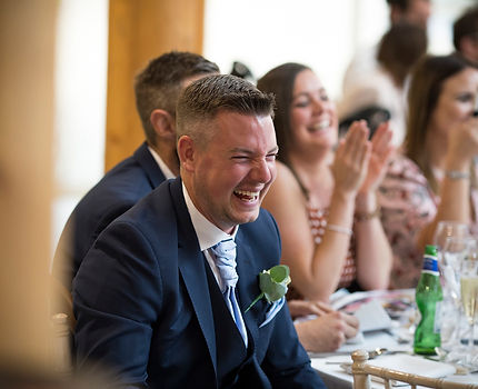 guests laughing at speech