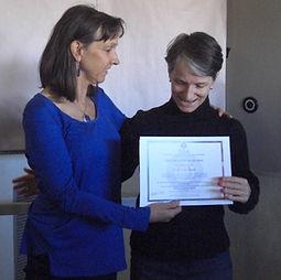 Jenner Miller presents student certificate Basic Theta Healing course