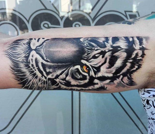 Tiger arm tattoo