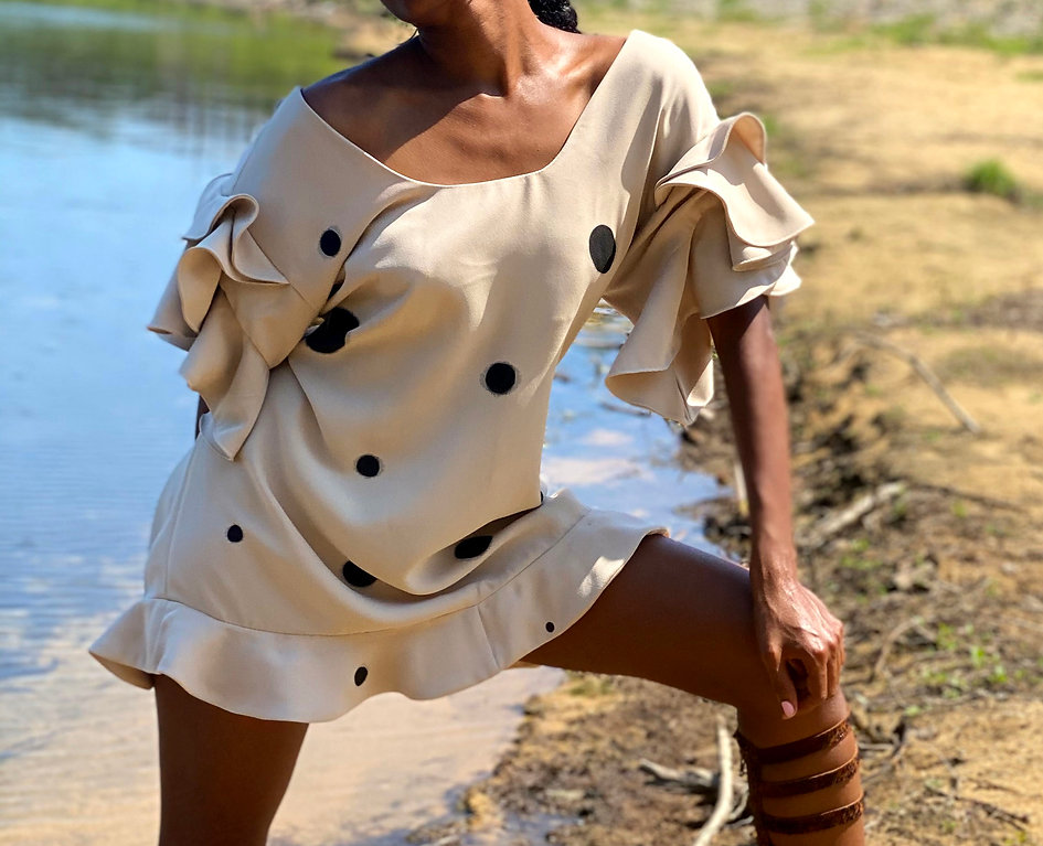Ruffled sleeve crepe de chine dress.