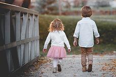 Two children walking on a bridge. Children's medicine. Pediatrics