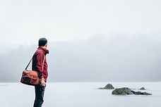 Man traveling misty lake