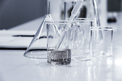 glass chemistry set on a white table