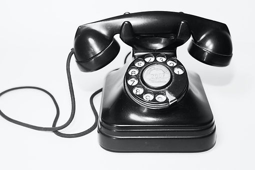 Black old school telephone with rotary dial