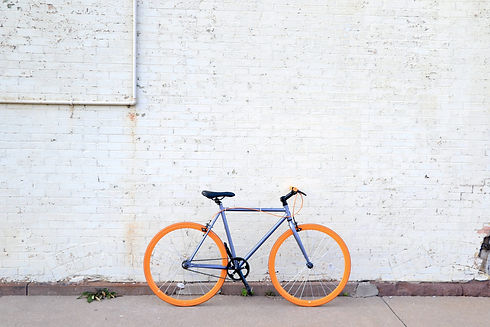 Bicycle against a white wall