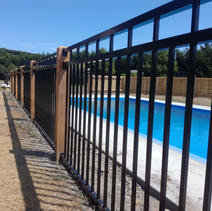 Pool Fencing using double toprail panel & wooden posts