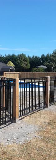 Aluminium Pool Fencing with Macrocarpa Posts