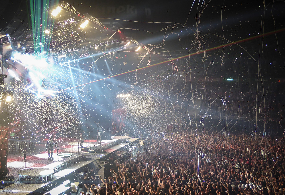 Large concert venue with stage and huge crowd