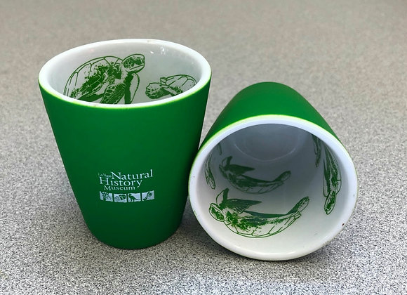 Green logo shot glass with sea turtles