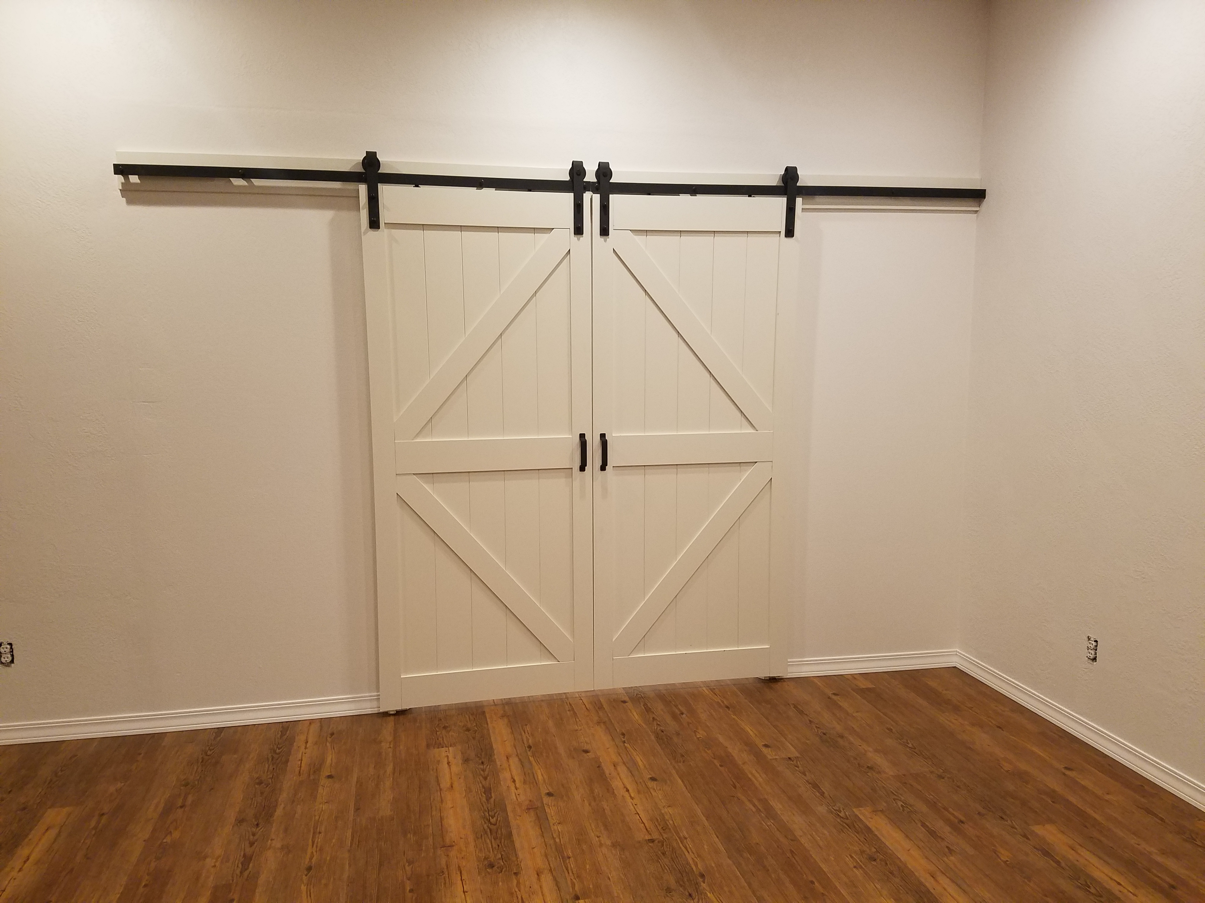 Finished Wall With Installed Barn Doors