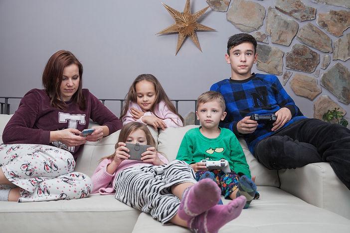 family-using-technologies-sofa.jpeg