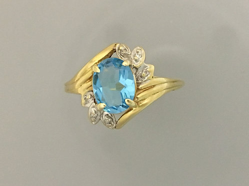 10k Yellow Gold One Carat Blue Topaz and .02 Diamond Ring Size - 7