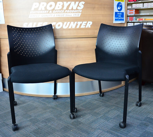 Pair of Black stacking visitor chairs on castors
