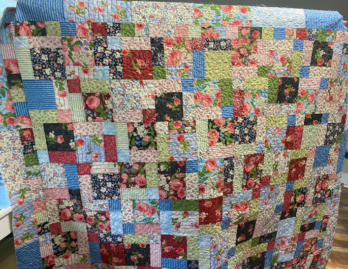 Pieced by: Suzi Rourke and Quilted by: Fork Mtn Quilting