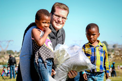 Pastor Peter handing out blankets