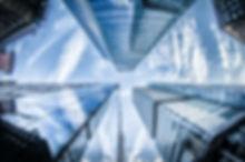 low-angle-photo-of-four-high-rise-curtai
