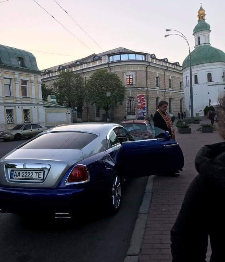 A UOC-MP Priest in a Bentley