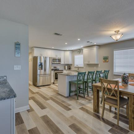 Sunset Condo Living Room & Kitchen