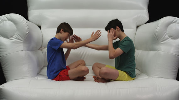 Two boys hand gesture, talking it out, WITS IN MOTION