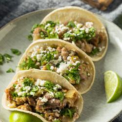 Homemade Pork Carnitas Tacos with Cilantro and Cojita.jpg