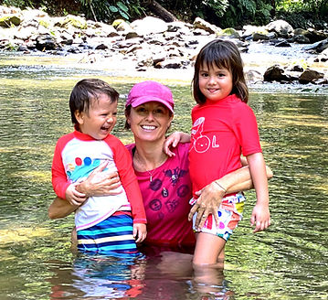 Photo of the yoga teacher with her two children.  My yoga journey. Koh Lanta. Thailand.