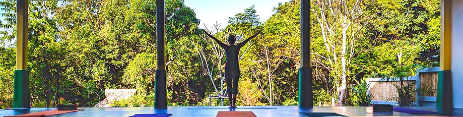 Photo of the yoga teacher standing at Lanta Yoga shala in Koh Lanta in Thailand. My Yoga Journey.