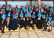 Group of students holding Plaza College Folders