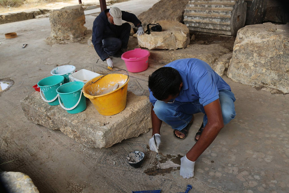 Conservators with the Libyan Department of Antiquities clean and consolidate mosaics at the UNESCO World Heritage site of Cyrene