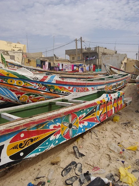 Colorful pirogue fishing boats along the shore of Saint-Louis.