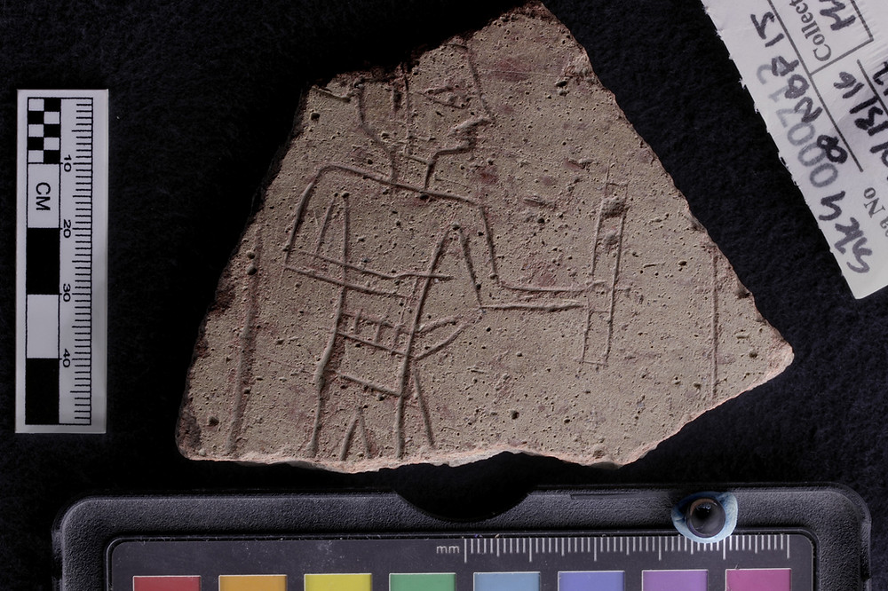 etched pot sherd of scribe holding ink palette