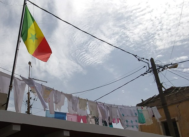Rooftop laundry with the Senegalese flag.