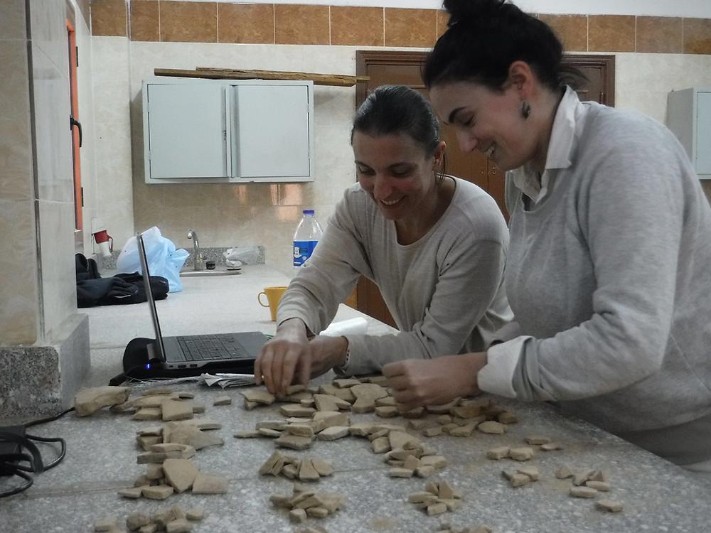 Members of the Wadi el-Hudi Expedition examine sherds in Egypt