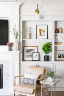 White built-ins with brass lighting