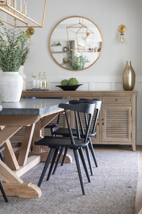 Modern farmhouse dining room with black chairs