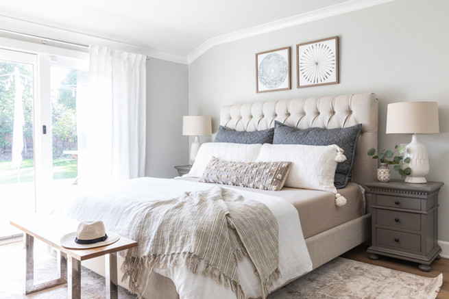 Master bedroom with Benjamin Moore grey owl walls and layered bedding