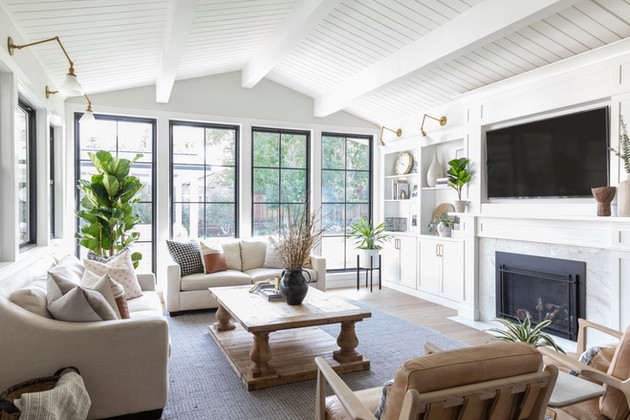 Great room with vaulted ceiling and black windows