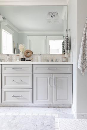 Marble bathroom floors with grey cabinets