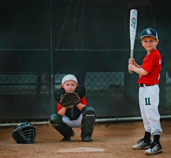 Brothers playing baseball