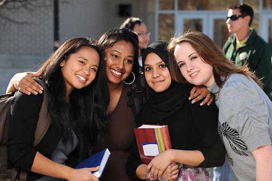 108475978_teens in front of school.jpeg