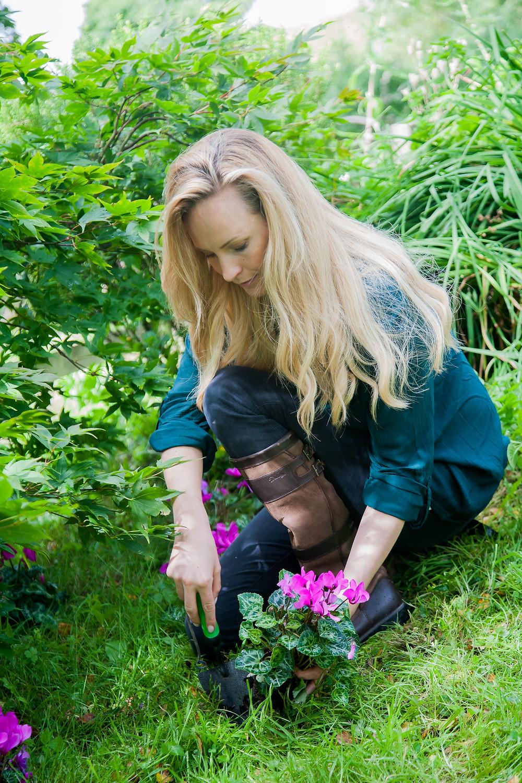 Gardener Leonie Cornelius planting flowers in her garden
