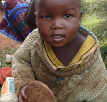 Child eating during famine relief program in East Africa, Mercy Partners