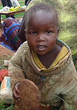 Food Relief program by Mercy Partners, Child being feed rations