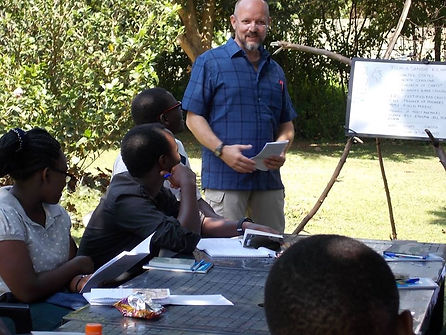 Tom Kilian of Mercy Partners teaching in Uganda during hosted church leadership training and conference