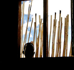 South Sudanese Boy staring inside school and church building, Mercy Partners, Thomas Kilian